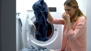 why does my front load washer smell bad